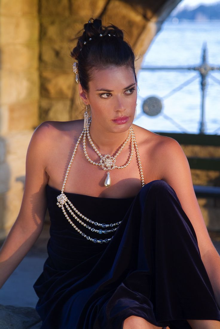 Baroque pearl halter design, with brooches.