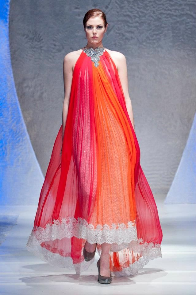 deepak perwani collection | pakistan fashion week | london 2012 | gorgeous shades of red, orange and pink trimmed with silver white lace embellishment | flowing long anarkali style gown