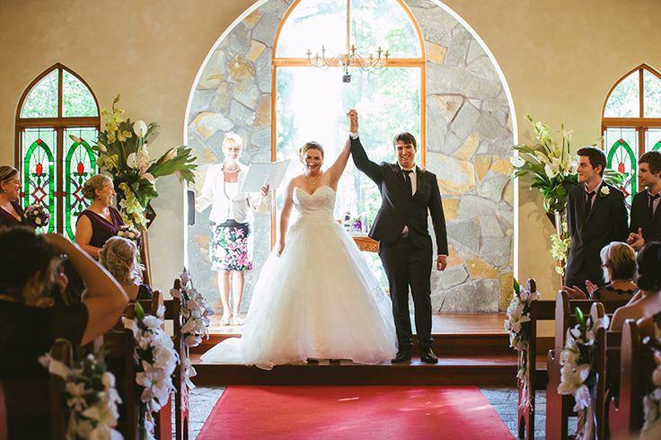 Bride and groom celebrating at chapel | Fist pump cheers | Coolibah Downs Wedding | Eliza Davis - Gold Coast Wedding Photographer |