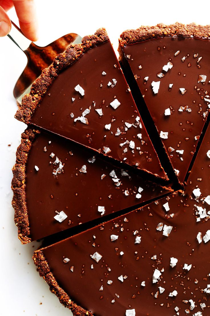 LOVE this Salted Dark Chocolate Tart recipe! It's quick and easy to make ahead, made with a gluten-free almond crust and zero heavy cream, and it's SO decadent and delicious. The perfect dessert for Valentine's Day or anytime you're craving some chocolate. | Gimme Some Oven #valentinesday #chocolate #chocolatetart #darkchocolate