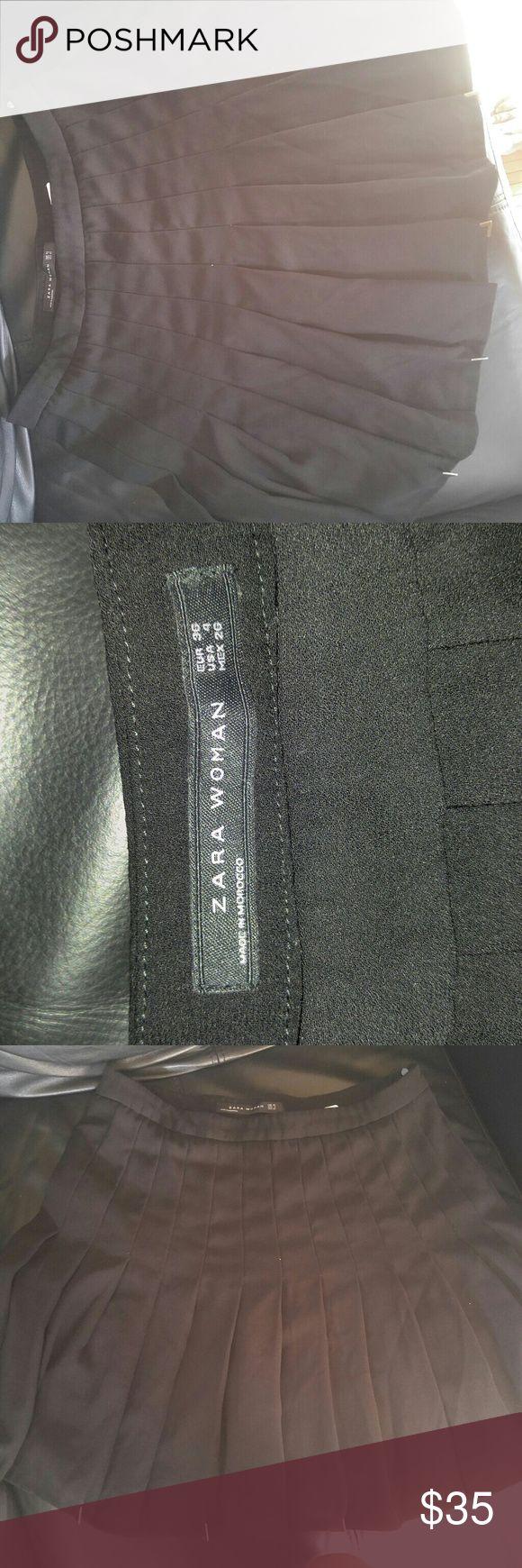 Zara skirt A black pleated schoolgirl skirt has some gold trim at the bottom. Zara Skirts Midi