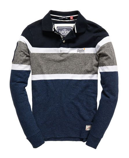 Superdry men's long sleeved Concorde polo shirt. A long sleeved version of the classic Superdry jersey polo shirt featuring a block stripe design, an appliqué design on the sleeve, two button fastening, velvet lined collar, reinforced side seams and finished with a Superdry logo dart in the side seam and a logo patch on the hem.
