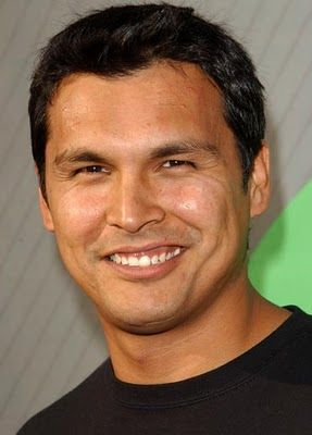Adam Beach was born (1972) in Ashern, Manitoba. He is a Canadian Saulteaux actor.  He is best known for his roles in Smoke Signals, Texas Ranger, Joe Dirt, Flags of Our Fathers, Windtalkers, Bury My Heart at Wounded Knee, Law & Order: Special Victims Unit, and in the film adaptations of Skinwalkers, Coyote Waits, and A Thief of Time. He is currently starring in Arctic Air.  Google Image Result for…
