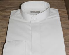 Banded collar dress shirts use a 'band' instead of a traditional collar. You can wear banded collar shirts with a suit or a sporty coat.