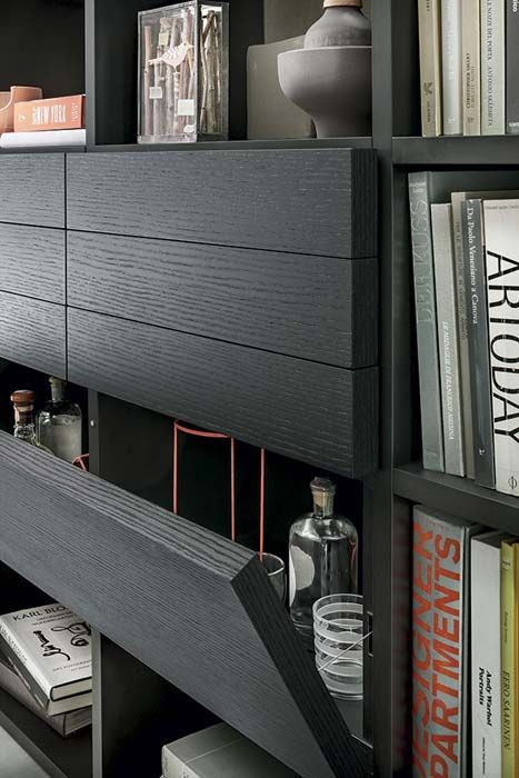LEMA | SELECTA, Custom Made bookcase by Officinadesign Lema, is the first product that combine the details of manual work on wood to a series of technical innovations that confer it maximum versatility in terms of compositions, uses and finishes. Here is shown a composition with Carbone oak fronts with extra-thick doors of 4 cm instead of 2 cm.