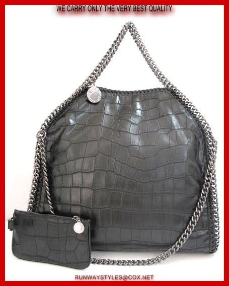 "Stella McCartney Falabela Black Croc Embossed Bag. Crocodile-embossed vegan-friendly foam-like faux leather (polyurethane/polyester).Signature whipstitching & curb-chain trim. Top handles W/ 9"" drop & logo charm. Slouchy, yet structured body may be folded over & carried like a clutch. Dipped top W magnetic-snap closure. Logo jacquard fabric lining Inside one zip pocket. Includes matching zip pouch attached to lobster-clasp chain. 16"" square x 5""D; pouch, 4""H x 7""W x 1/4""D. Weighs 1lb. 11oz."