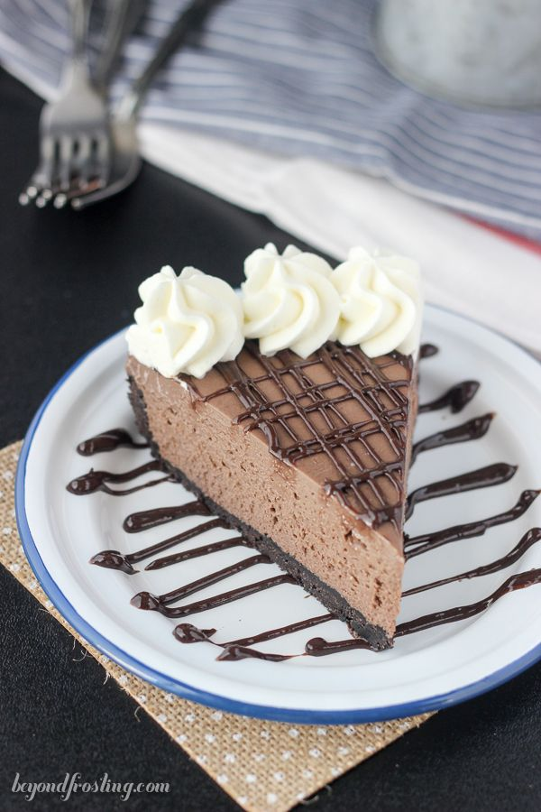 Gooey No-Bake Brownie Batter Cheesecake. A dense Oreo crust filled with a no-bake chocolate cheesecake made with…