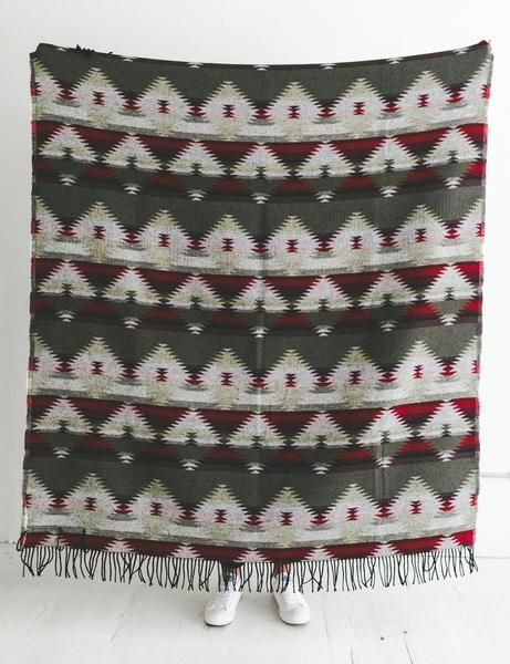 By purchasing this blanket, you will also be providing a blanket to your local homeless shelter. This wool blend is a medium/heavy weight blanket that can be used for beautiful home decor or outdoor adventures.