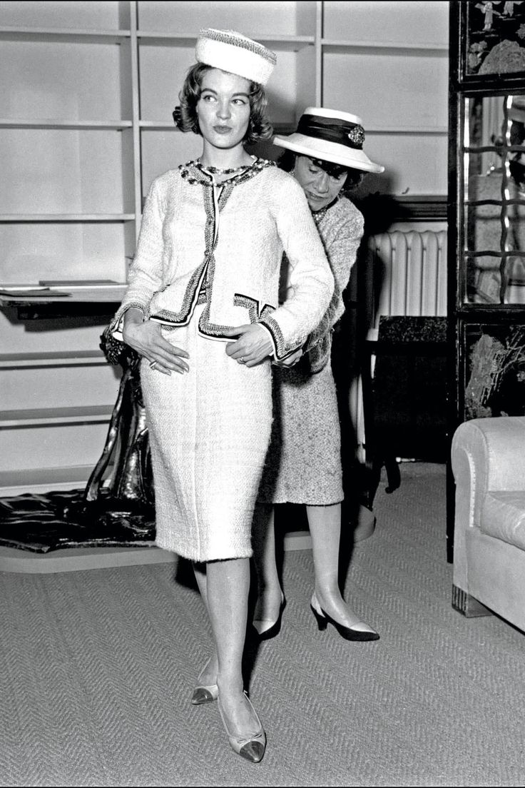 Coco Chanel in her atelier fitting actress Romy Schneider in the 1960s