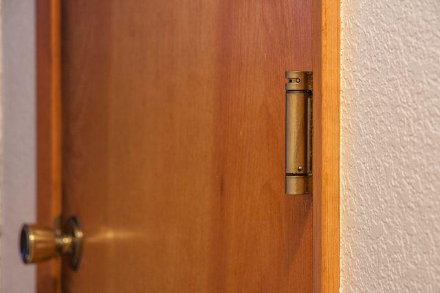 How to Adjust a Spring-Loaded Door Hinge