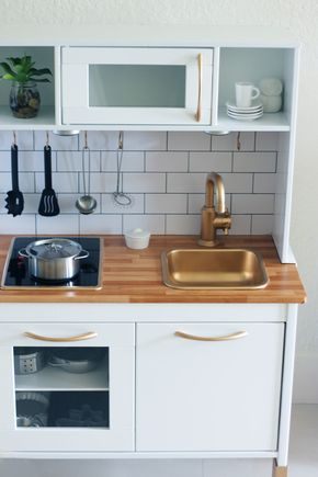 """""""Butcher block"""" wood-like contact paper for counter. IKEA Tag handles. Stick-on led lights."""