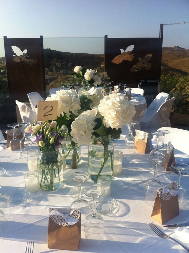 Wedding Table Decoration for the wedding dinner. White Flowers.Summer Wedding in Aigis Suites