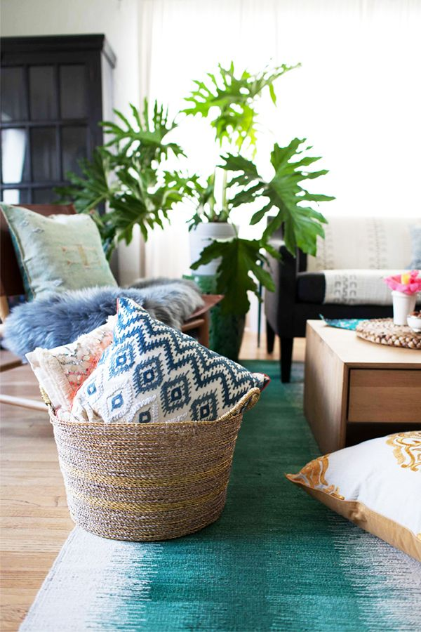 use a pretty basket for extra floor cushions and pillows for guests to sit on! | coco kelley