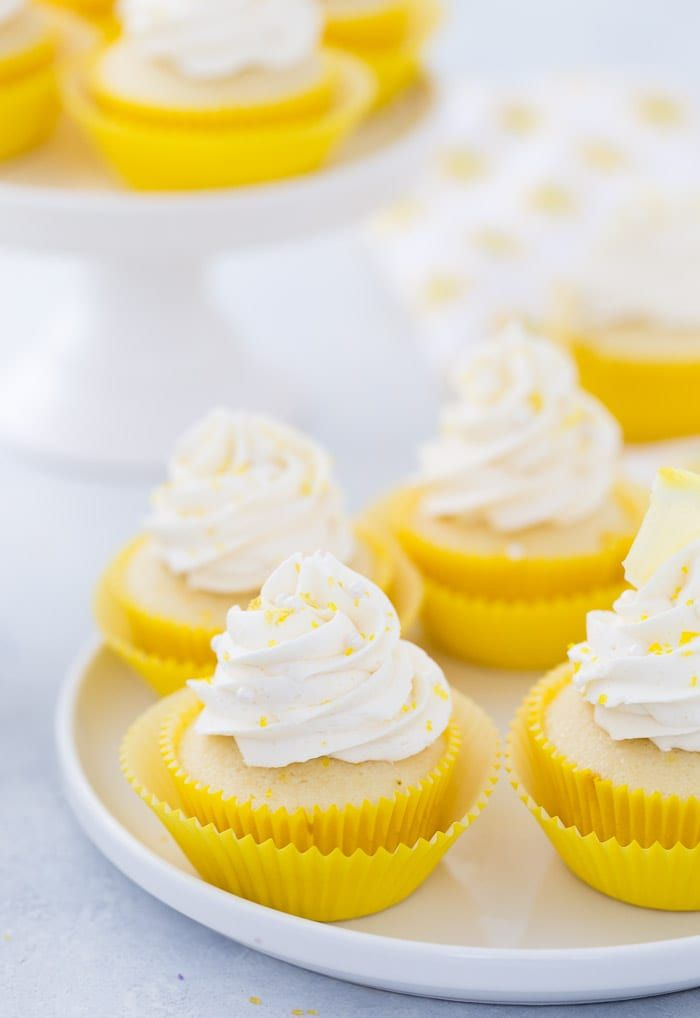 These lemon cupcakes are filled with fresh lemon flavor with lip puckering sweet lemon frosting. #cupcakes #lemon