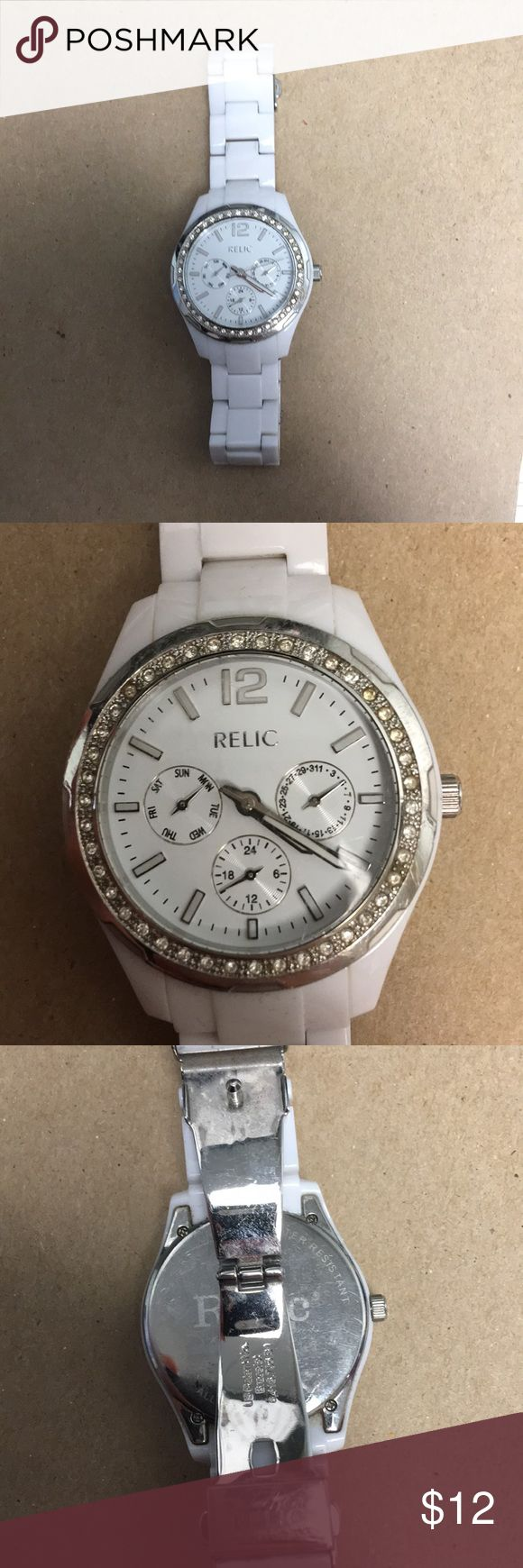 Relic watch White Relic ladies watch. Needs battery. Does have some wear. See pictures. Relic Jewelry