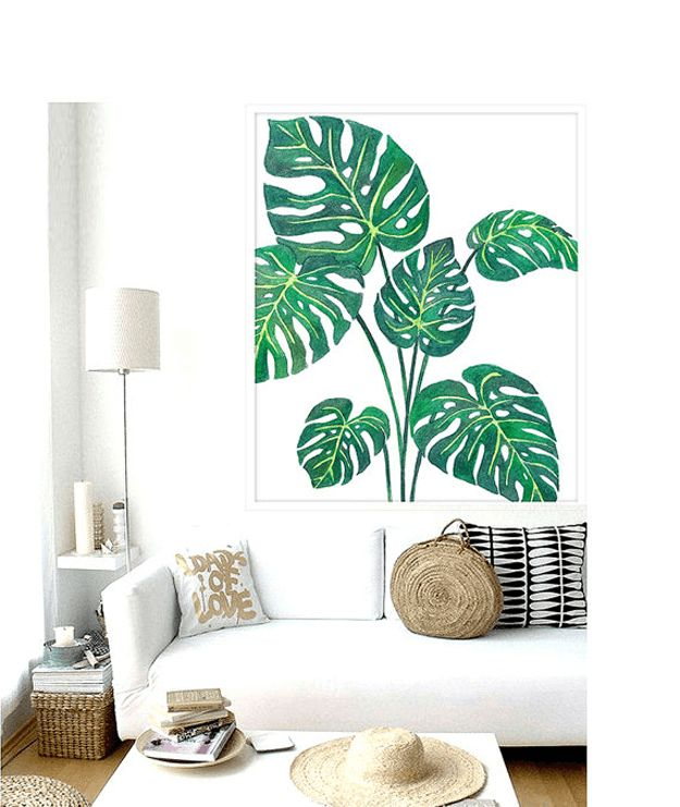 white modern living room with palm leaf poster, tropical print art, interior design trends