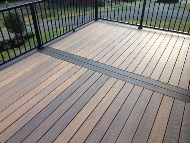 This beautiful deck was built with state-of-the-art Timbertech low maintenance Tigerwood decking with a mocha border.  The deck boards vary in color to give it an authentic appearance of real hardwood.