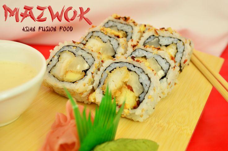 Karibukai: Sushi variado y exquisito compuesto de róbalo en tempura, yuca, masago y queso costeño