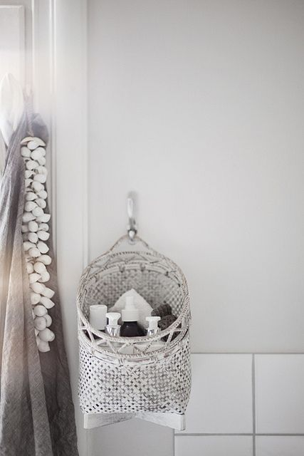 great idea: hang up a basket to fling all the bathroom bits and bobs in