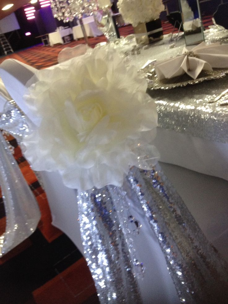 Fancy chair covers. Crystal and sequins, giant flowers