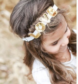 Wearing the love on your head is kind of like wearing your heart on your sleeve, right? These beautiful headbands from Arrow + Lace definitely spread the love.