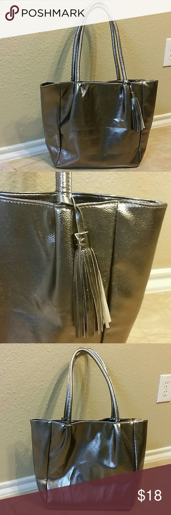 """Ultra Chi tote Silver color tote, great space inside with zippered pocket and slip pocket. Measures approximately 12x17x5"""", strap drop 10.5"""" Tiny nick (see last picture) Ultra Chi Bags Totes"""