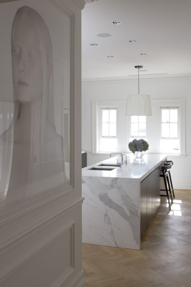 Waterfall marble island, light wood herringbone floors. Love the warm taupe with the oyster grey and soft ivory.