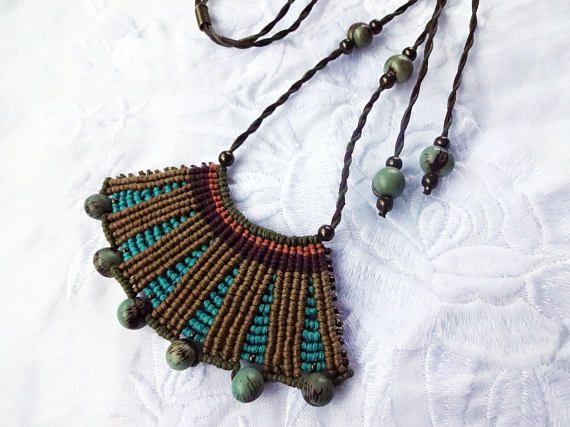 Eco friendly macrame necklace made with cotton cord, acai and metal beads.