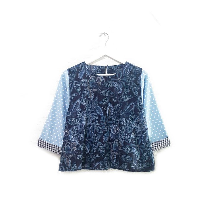 Marlene 002  IDR 340.000  Comfort Loose Fit Long Sleeve Batik Design and Polkadot Combination Blouse  Length of Blouse : approx. 55 cm  Material Used : Contemporary Batik Design, Cotton / Premium Polkadot Cotton  Free Size (Bust up to 100 cm)  Note : One Button at the back for opening