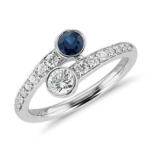 Shimmering pavé set diamonds and sapphires sparkle from the gracefully curved band, completing the elegant expression of your bond.
