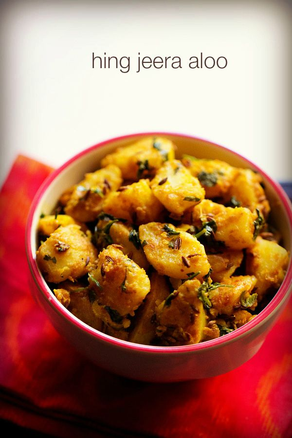 hing jeera aloo recipe - no onion no garlic dish of potatoes sauteed in a spice base of cumin, asafoetida and other spices. goes well with pooris or chapatis.