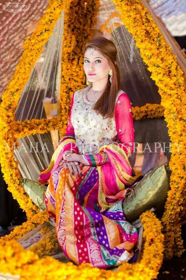 Pakistani mehndi bride.  Not really into the clothes but I love what she is sitting in