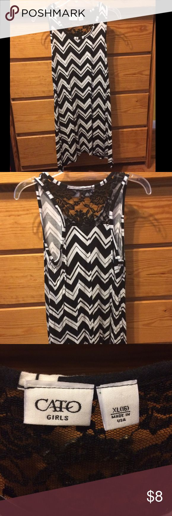 Chevron tank top Super cute tank top!! 😀 sadly, it's a little to tight for my liking. 😕 it's longer than a normal shirt, goes past the bum, and the sides go down longer. Black floral lace on the back at the top. Hardly worn. No flaws that I know of!! GIRLS SIZE!! Cato Tops Tank Tops