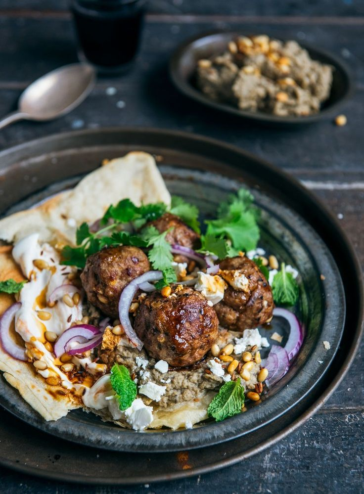 spiced meatballs, garlicky eggplant hummus, crunchy cumin-spiked pine nuts and fresh herbs.