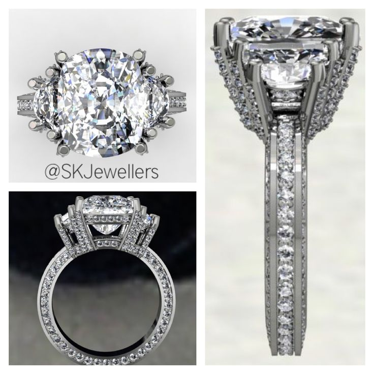Over 8.00 carats of diamonds in this Engagement Ring design. This design features a Cushion Cut Diamond with 2 Half-Moon shaped side diamonds. And accent sparkle on every side of the setting.  www.samuelkleinberg.com