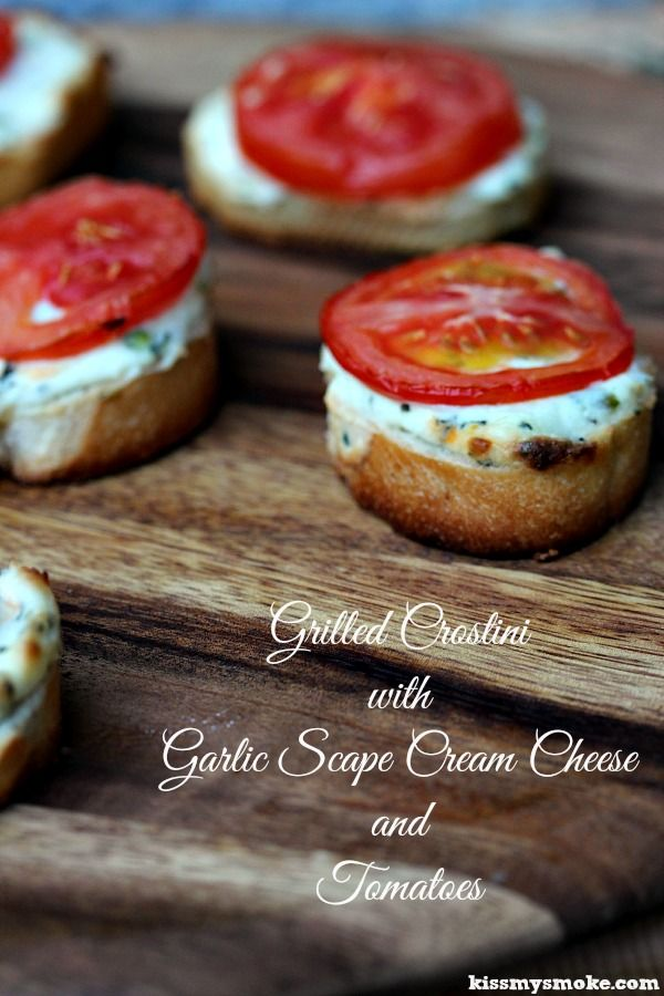 Grilled Crostini with Garlic Scape Cream Cheese and Tomatoes- Simple recipe to make garlic scape cream cheese to top on crostini for the grill. Get the recipe at kissmysmoke.com