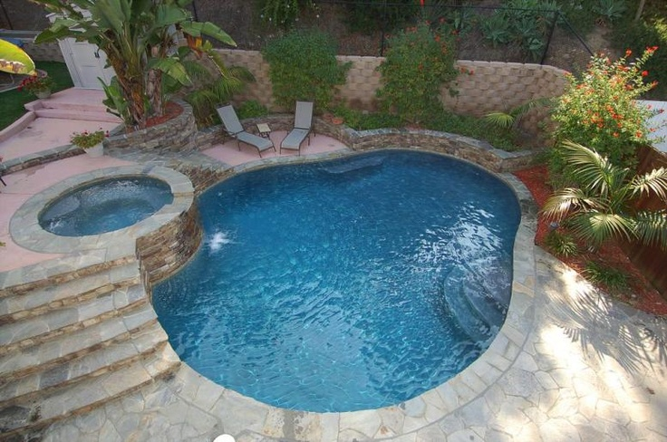 Gorgeous pool with raised spa awesome inground pool for Raised pool designs