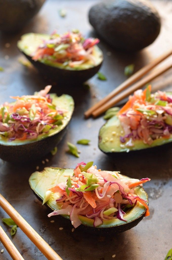 These Stuffed Avocados with Crunchy Sesame Cabbage Slaw have us dreaming of lunchtime!