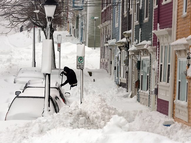 Residents along Gower Street try to dig out in the aftermath of a snowstorm in St. John's, Newfoundland, Canada. Jan 2013