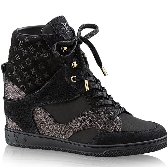 Louis Vuitton Cliff Top Wedge Sneaker - 7.5 This must-have hi-top sneaker in nubuck grained calf leather boasts an innovative construction with a hidden wedge heel. The elaborate upper features a patchwork of leathers, including a Monogram-embossed padded collar. Brand new. Size 7.5. Comes with Extra black regular laces and cards of authentication, as well as original box. Louis Vuitton Shoes Wedges