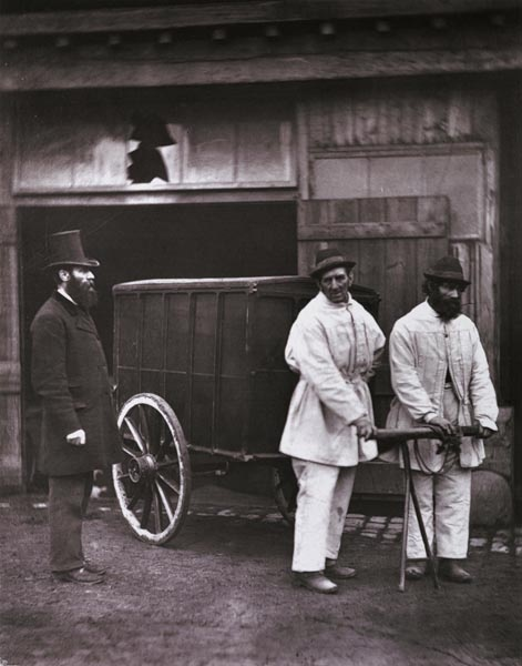 Public disinfectors, Pimlico, c. 1877. Photographed in the yard adjoining the Vestry Hall close to Ebury Bridge, Mr Dickson, the Inspector of Nuisances for the Parish or Union of St. George's, Hanover Square, stands on the left. The men are in front of the outhouse containing the disinfecting oven. Here the interiors, clothings and belongings from properties that have held severely ill and contagious people, were 'purified' before being returned. In addition, the properties ...