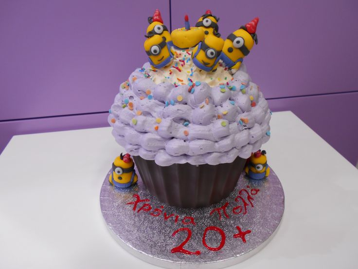Minions on a giant cupcake singing happy birthday