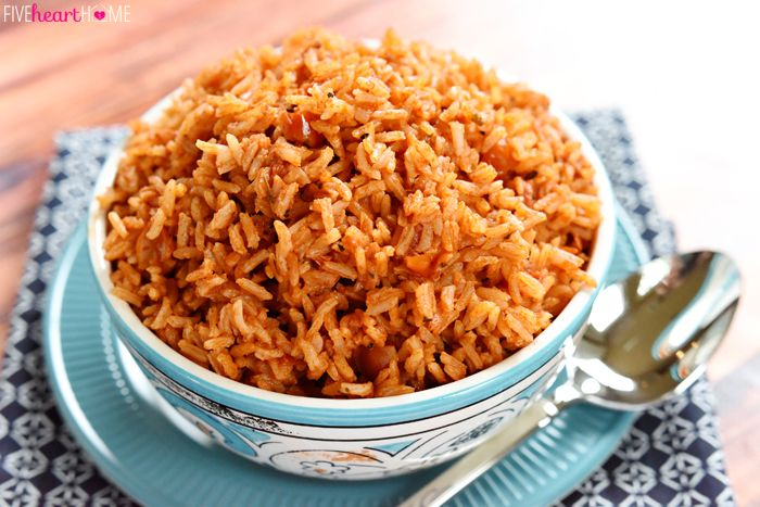 Easy Spanish Rice Recipe Side Dishes with extra-virgin olive oil, butter, white rice, chicken broth, tomato sauce, chili powder, cumin, garlic salt, dried oregano, fresh tomatoes
