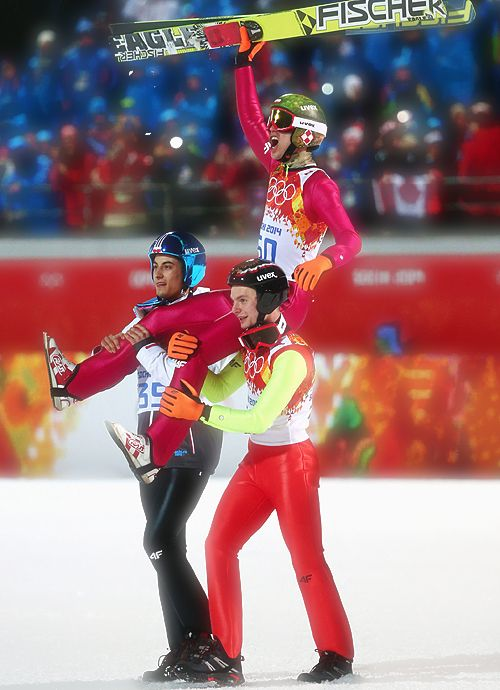 Kamil Stoch celebrating his win with Maciej Kot and Jan Ziobro