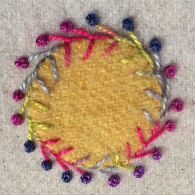 Closed fly stitch with French knots done in Sue's NEW Eleganza Perle cotton #8 over a wool applique. #suespargo @wonderfilspecialtythread