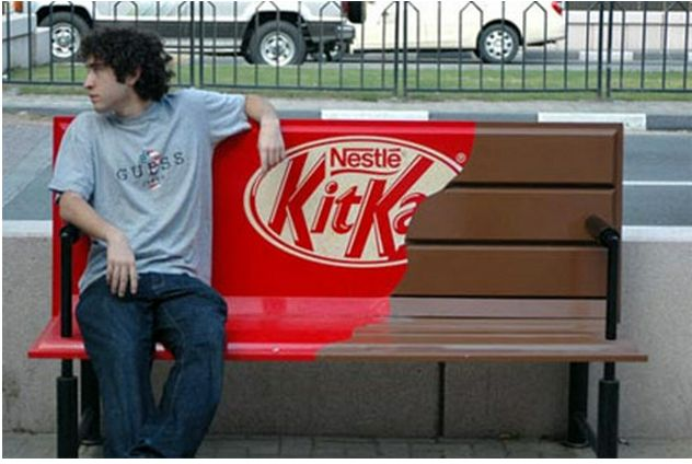 This ad is for Kit Kat, which is targeted for everyone. This technique is effective because some people sit on the bench and take a minute to look at their surroundings. This can cause them to crave for a kit kat bar, along with people who pass by this bench. Another reason why this is effective is because it is big and bold and many people pass by it and actually take time to look at it.