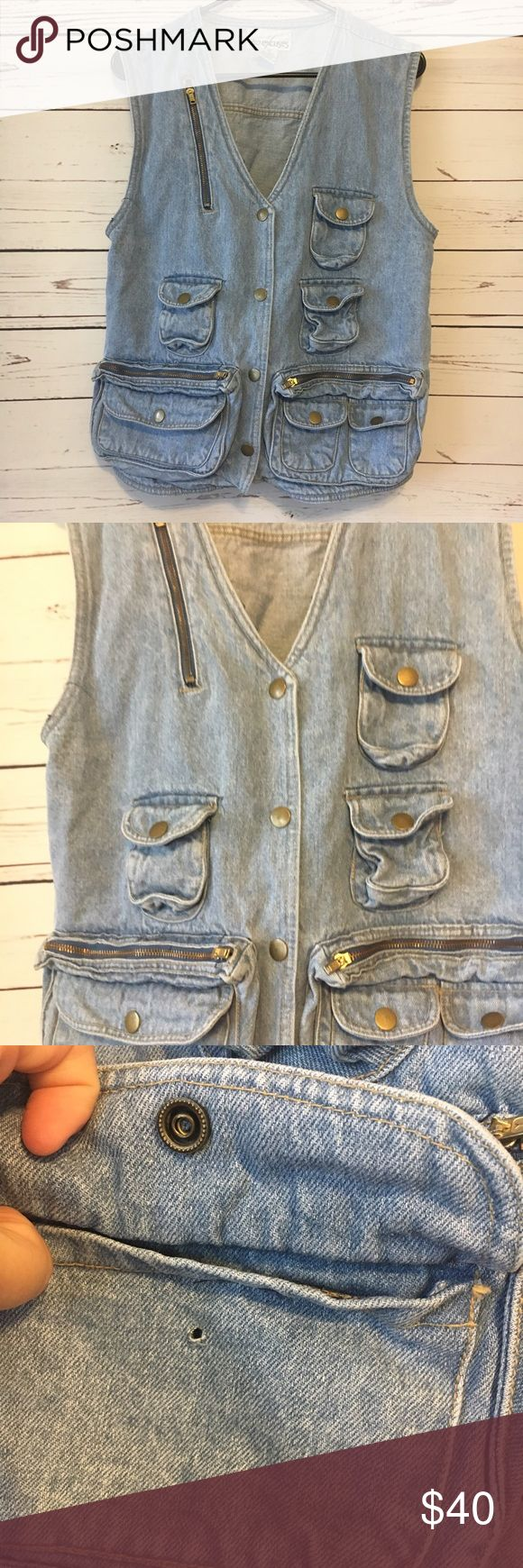 Vintage utility vest festival concert travel jean Vintage jean vest with purse like pockets. Perfect for festivals and concerts. This is best is like a fanny pack or purse. It has all the pockets you need. One bottom pocket does not snap but still holds things. As shown. Pocket big enough at least for an iPhone 6s with case on.  Keep your valuables close and safe while looking awesome. 18 arm to arm and 24 shoulder to hem. Vintage Jackets & Coats Utility Jackets