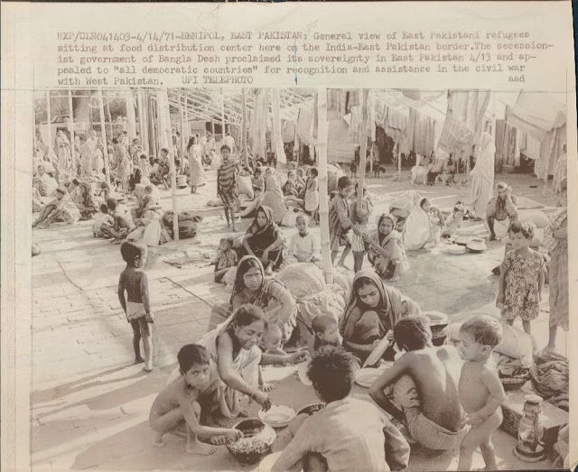 "Beniapol, East Pakistan: General view of East Pakistani refugees sitting at food distribution center here on the India-East Pakistan border. The secessionist government of Bangla desh proclaimed its sovreignty in East Pakistan 4/13 and appealed to ""all democratic countries"" for recognition and assistance in the civil war with West Pakistan"