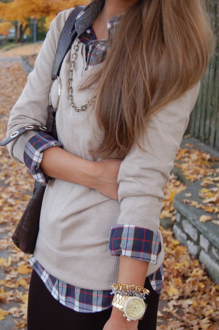 Plaid shirt, neutral v-neck sweater, nice accessories. Fall casual outfit idea.