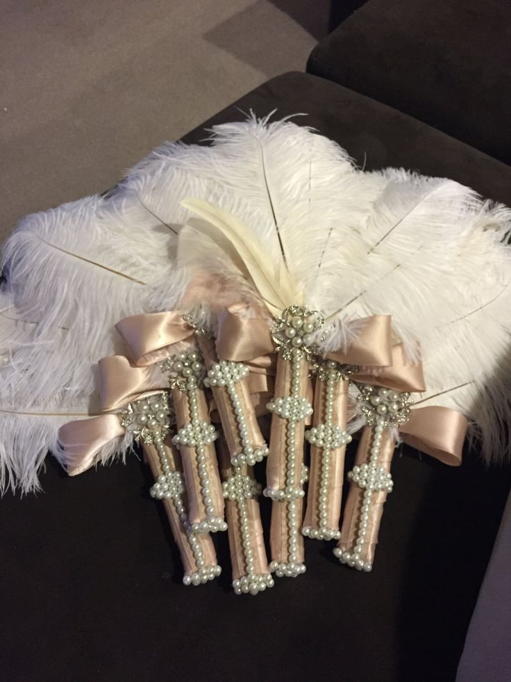 Interesting idea for bridesmaids  Ivory Ostrich Feather Fan w/ Pearls & by SofiaCraftsDecor on Etsy